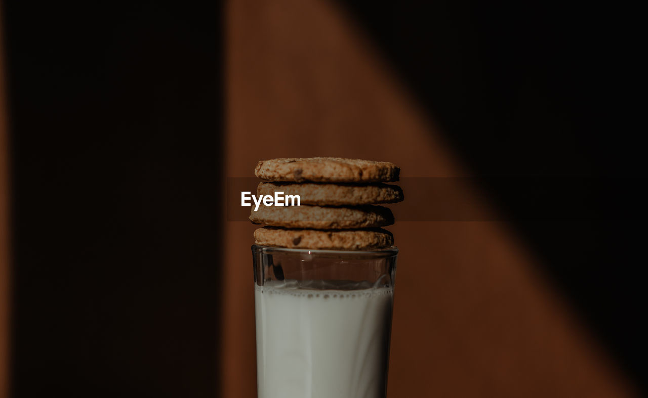 CLOSE-UP OF COOKIES IN GLASS
