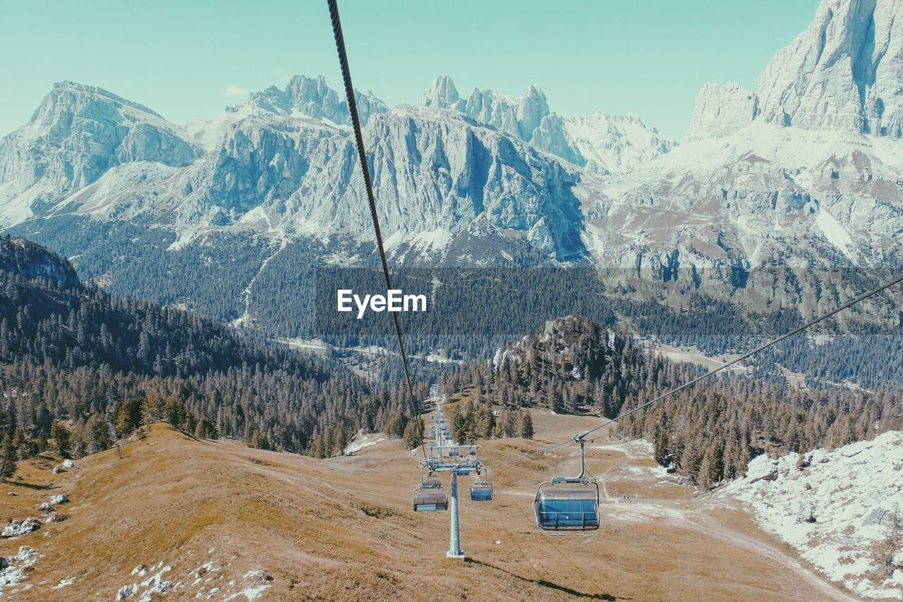 Ski Lift Against Rocky Mountains Against Clear Sky