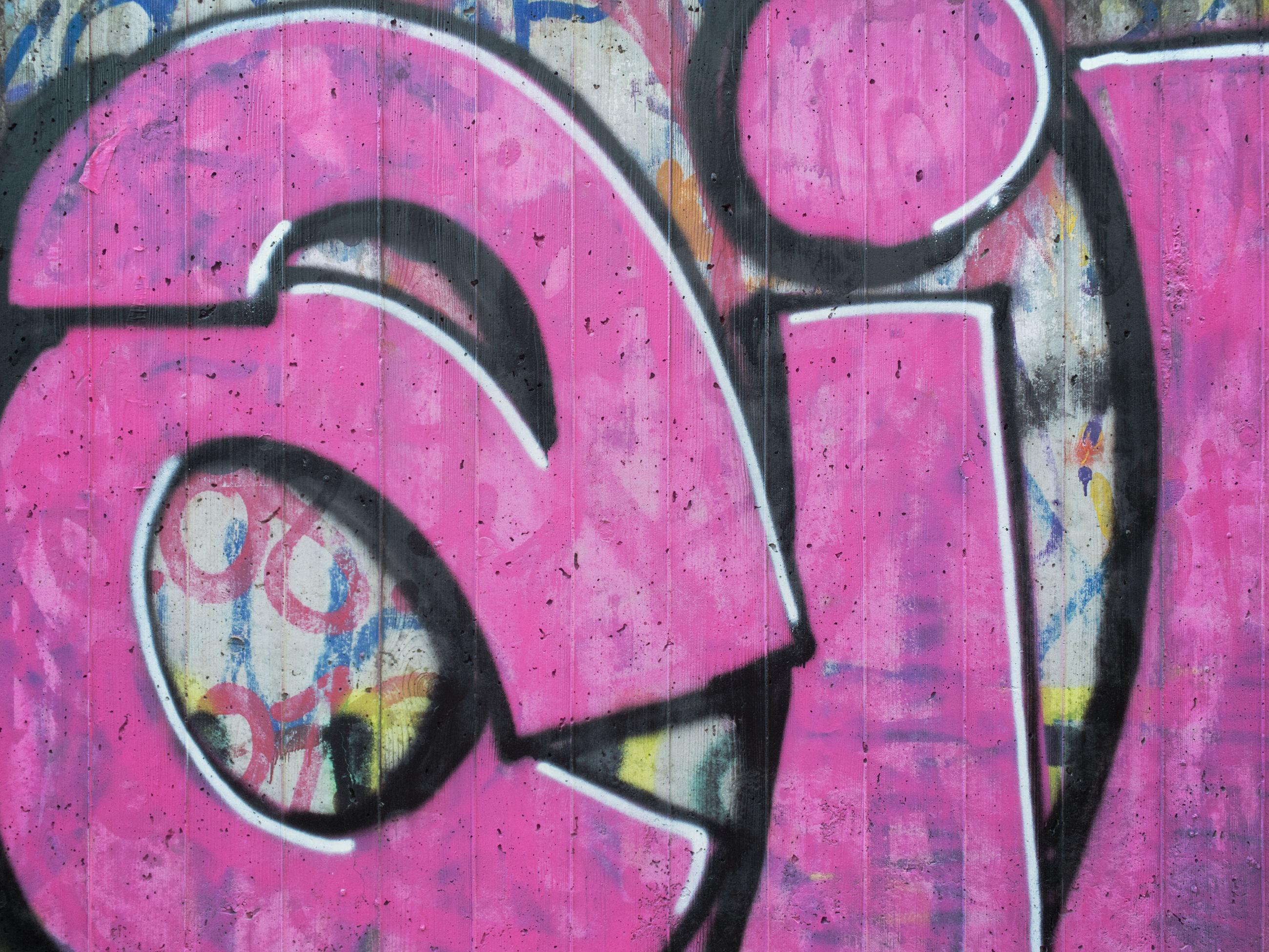 CLOSE-UP OF GRAFFITI ON METAL