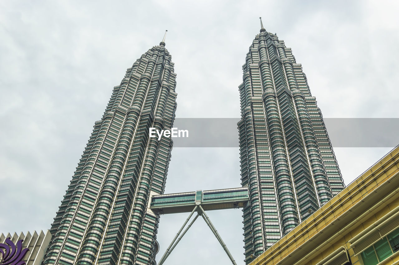 architecture, built structure, tall - high, skyscraper, low angle view, building exterior, tower, sky, modern, city, travel destinations, day, outdoors, travel, no people
