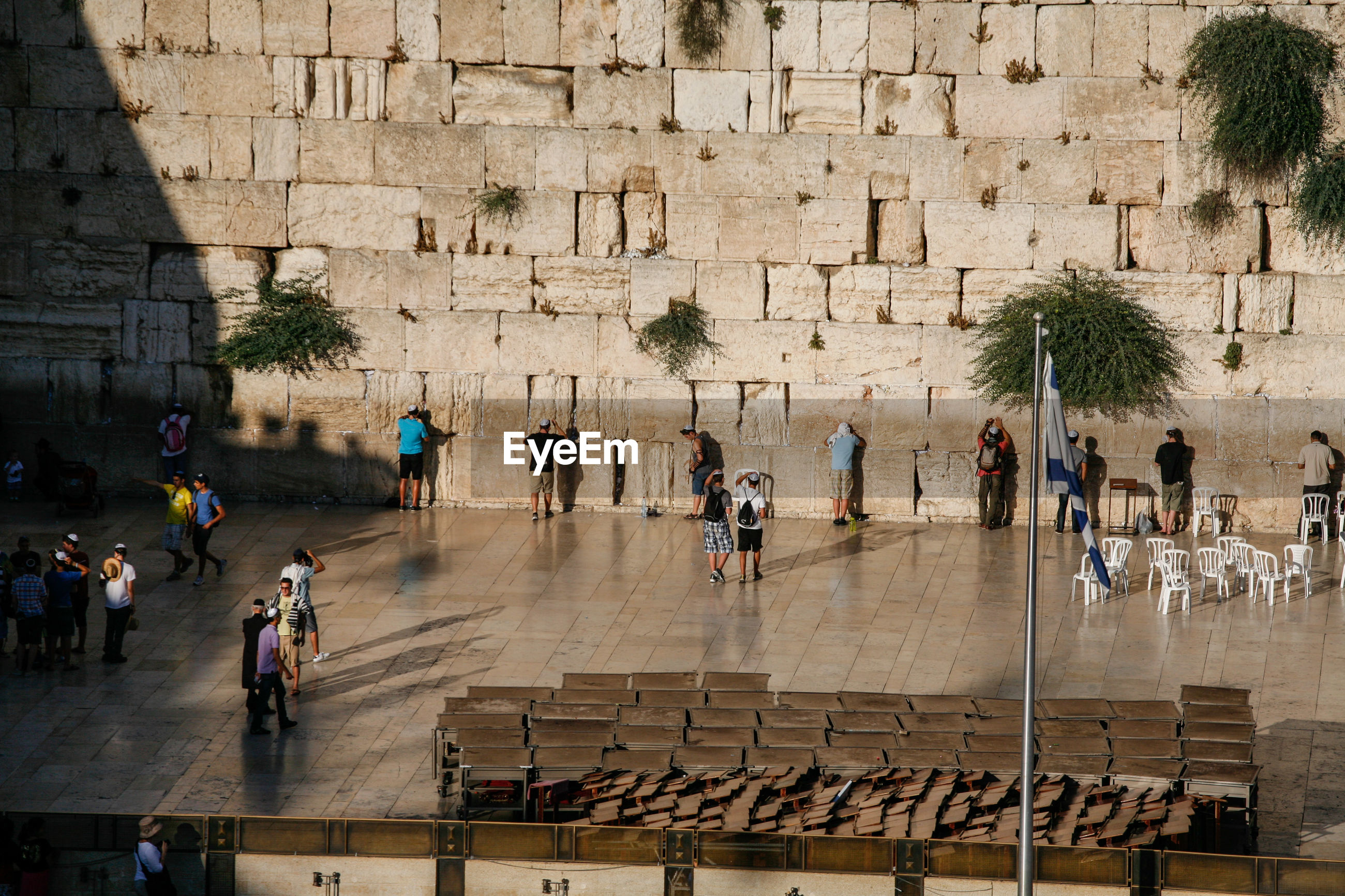 High angle view of people in front of historical building