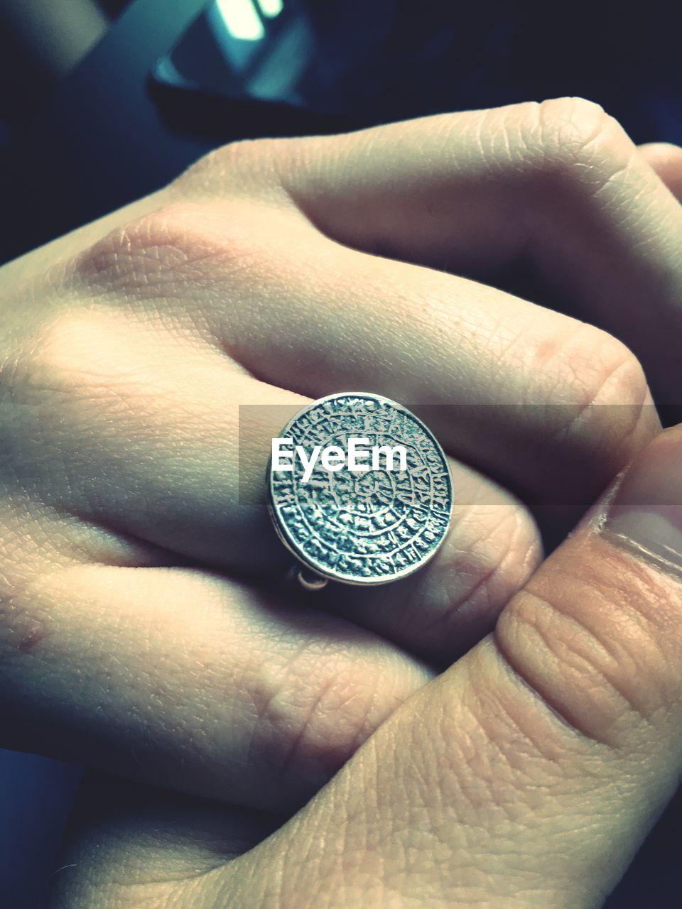 human body part, human hand, hand, finance, real people, one person, close-up, body part, holding, unrecognizable person, currency, coin, finger, high angle view, indoors, human finger, wealth, lifestyles, metal, silver colored