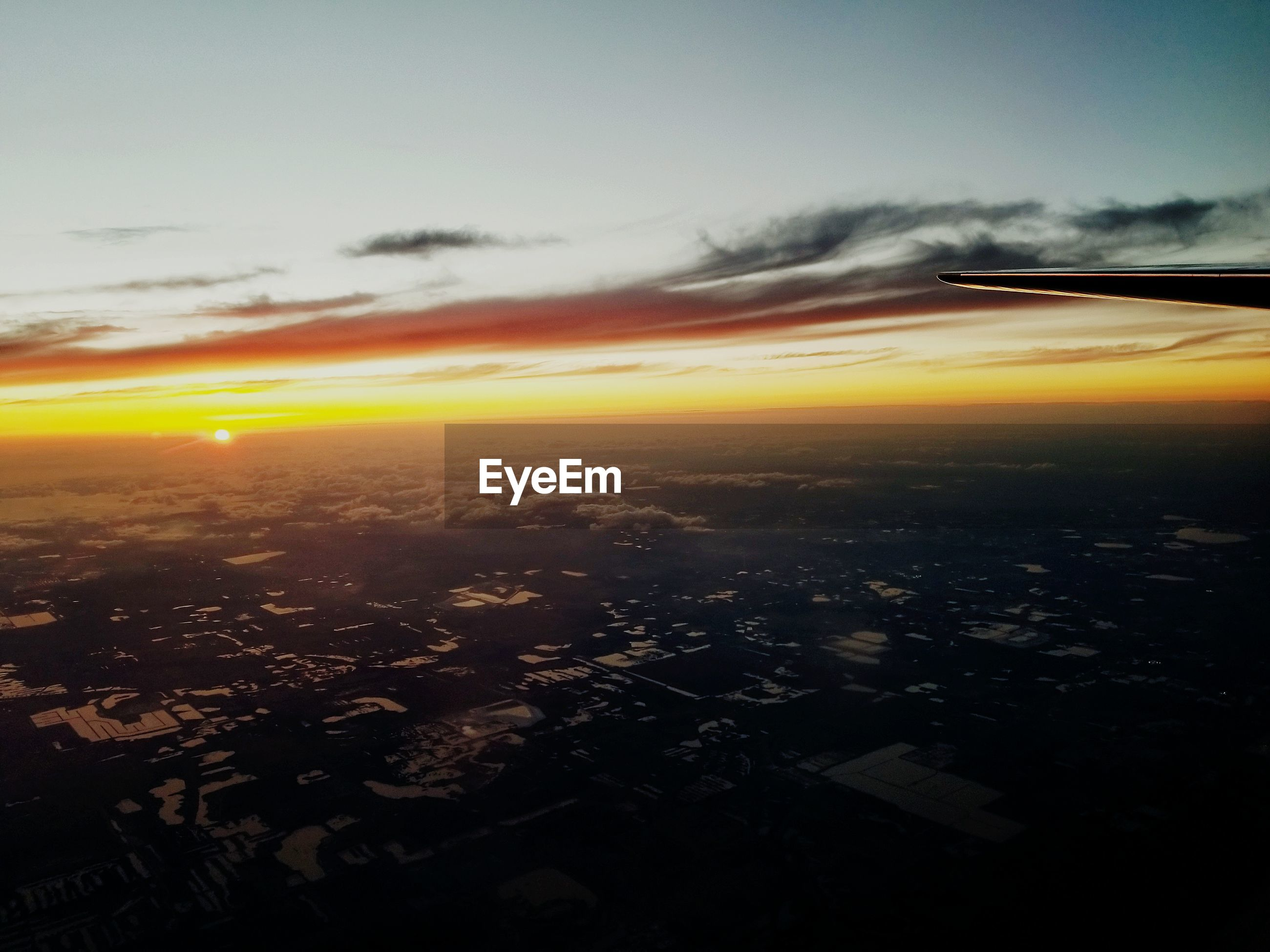 Aerial view of landscape against sky during sunset