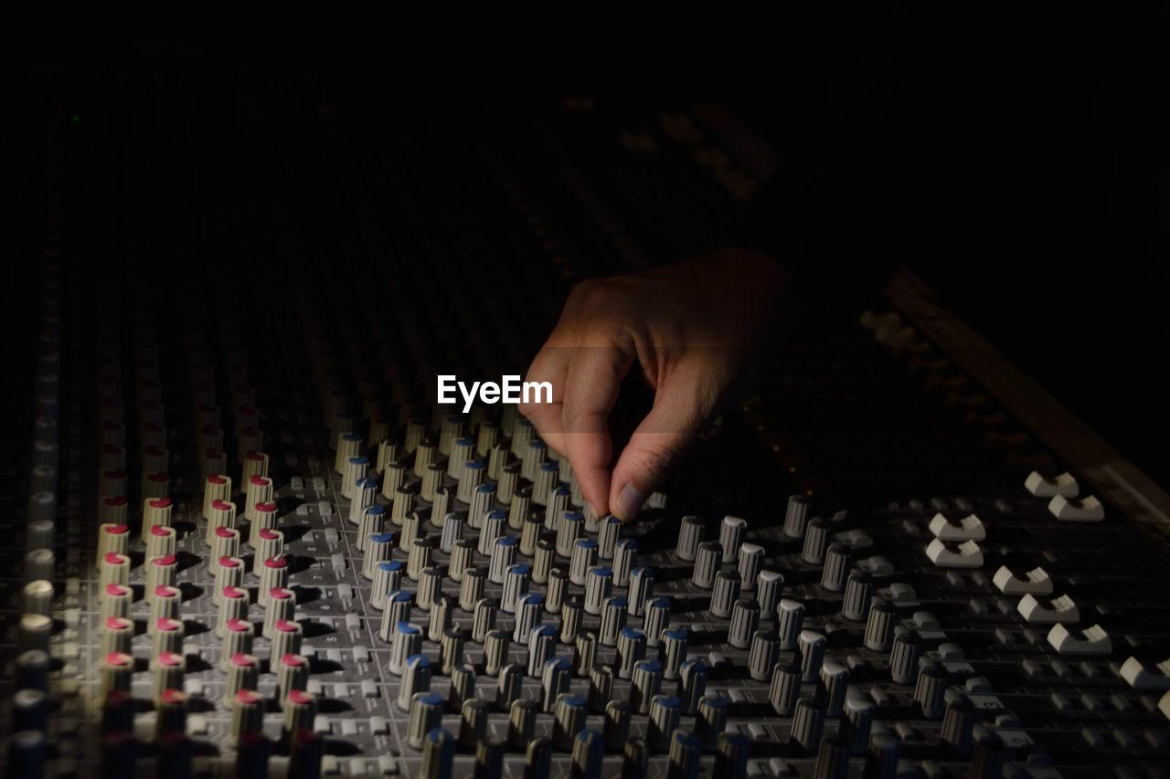 Close-Up Of Man Controlling Sound Mixer