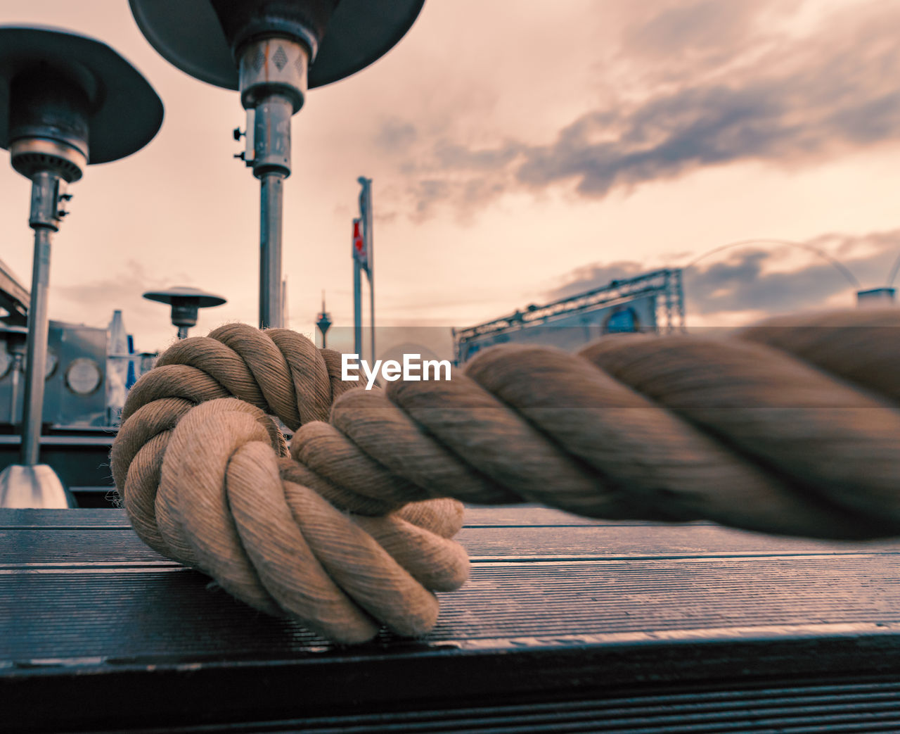 sky, no people, close-up, focus on foreground, transportation, rope, day, nature, outdoors, mode of transportation, nautical vessel, cloud - sky, textile, railing, wood - material, sunset, selective focus, built structure, wool, still life