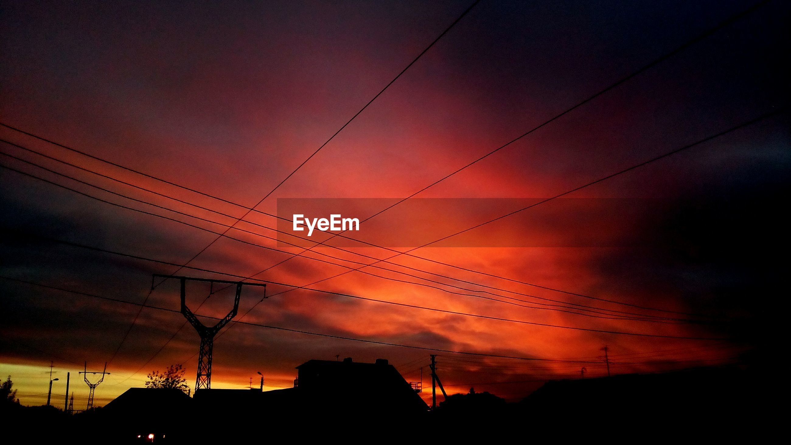 silhouette, architecture, built structure, power line, low angle view, building exterior, cable, electricity, sky, sunset, power supply, cloud - sky, dramatic sky, cloud, electricity pylon, atmospheric mood, high section, power cable, cloudscape, outdoors, scenics, moody sky, majestic, no people, back lit, romantic sky, cloudy, atmosphere