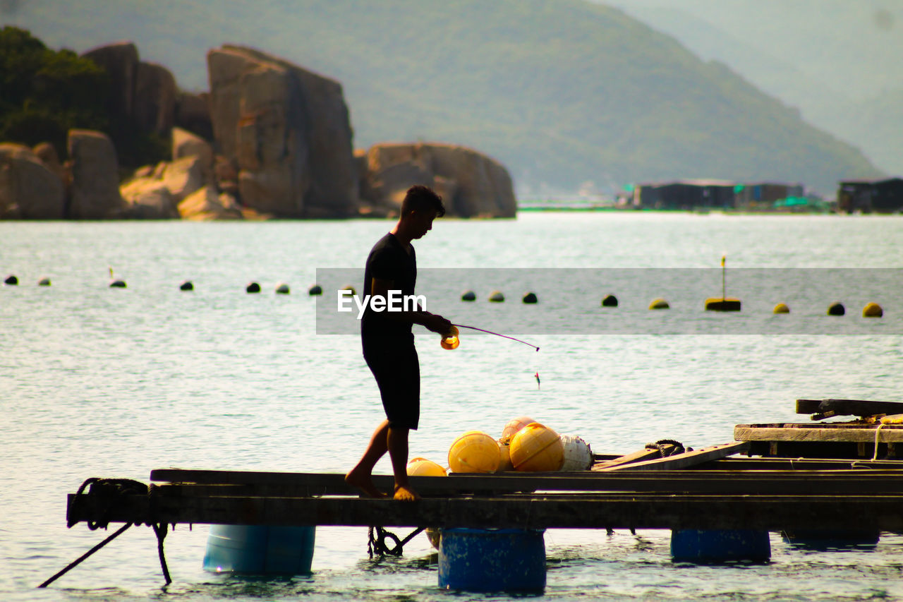 Man on jetty