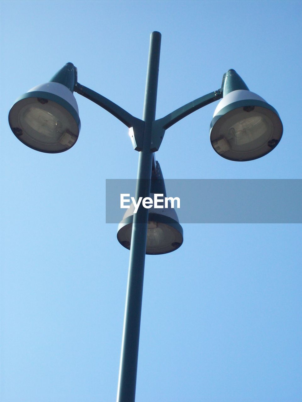 low angle view, clear sky, day, no people, blue, outdoors, sky