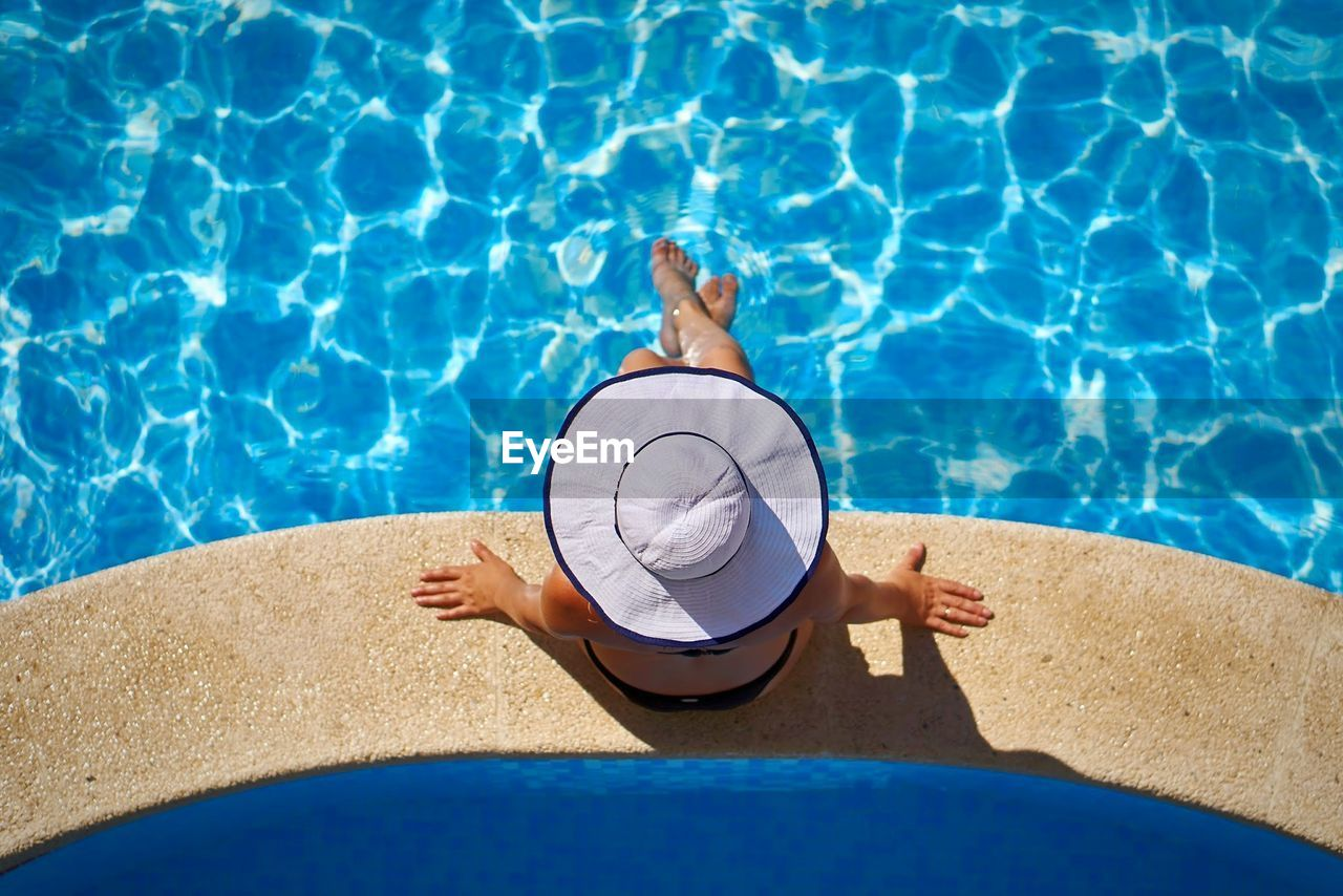 High Angle View Of Woman At Swimming Pool