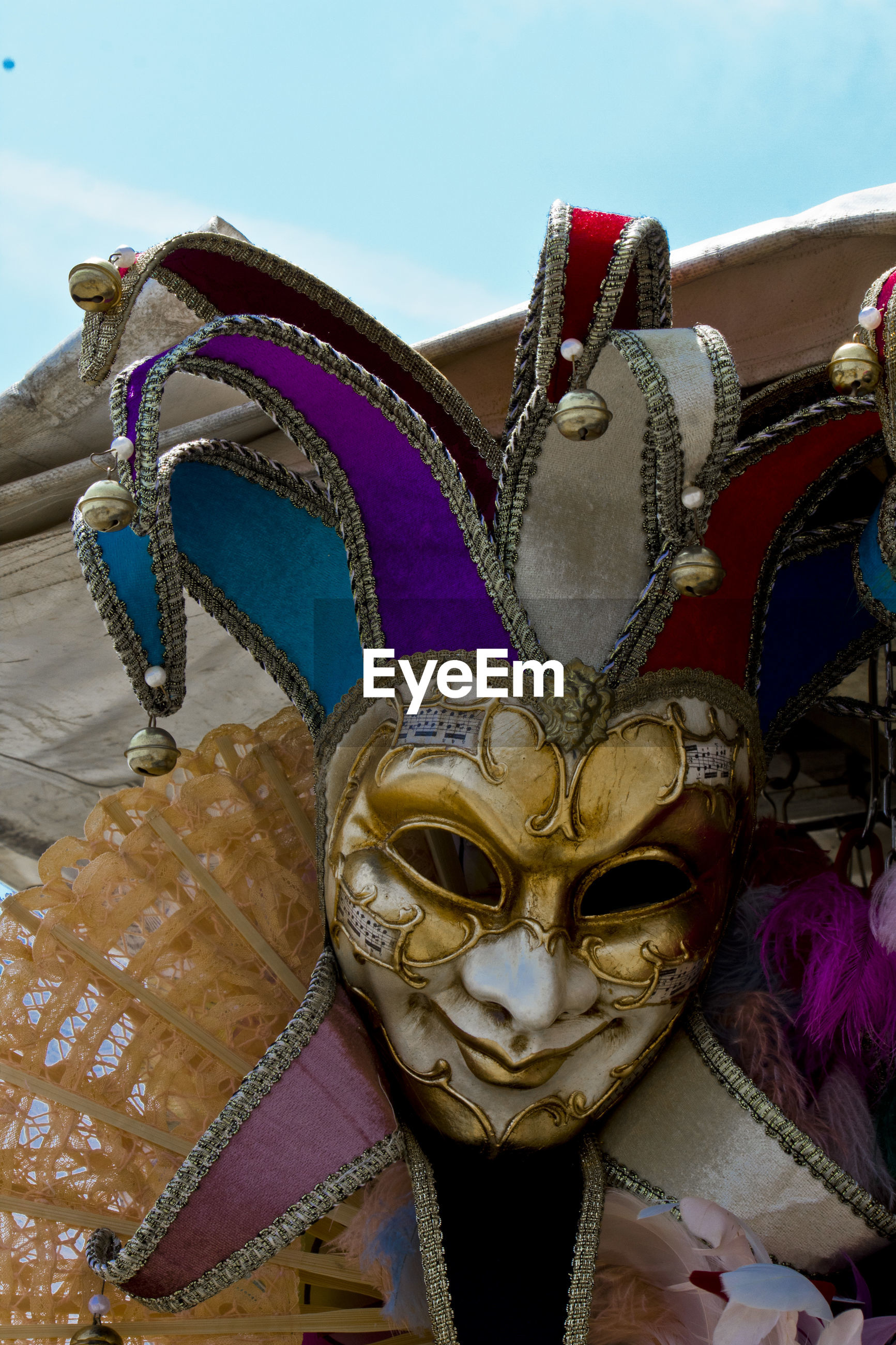Close-up of venetian mask against sky