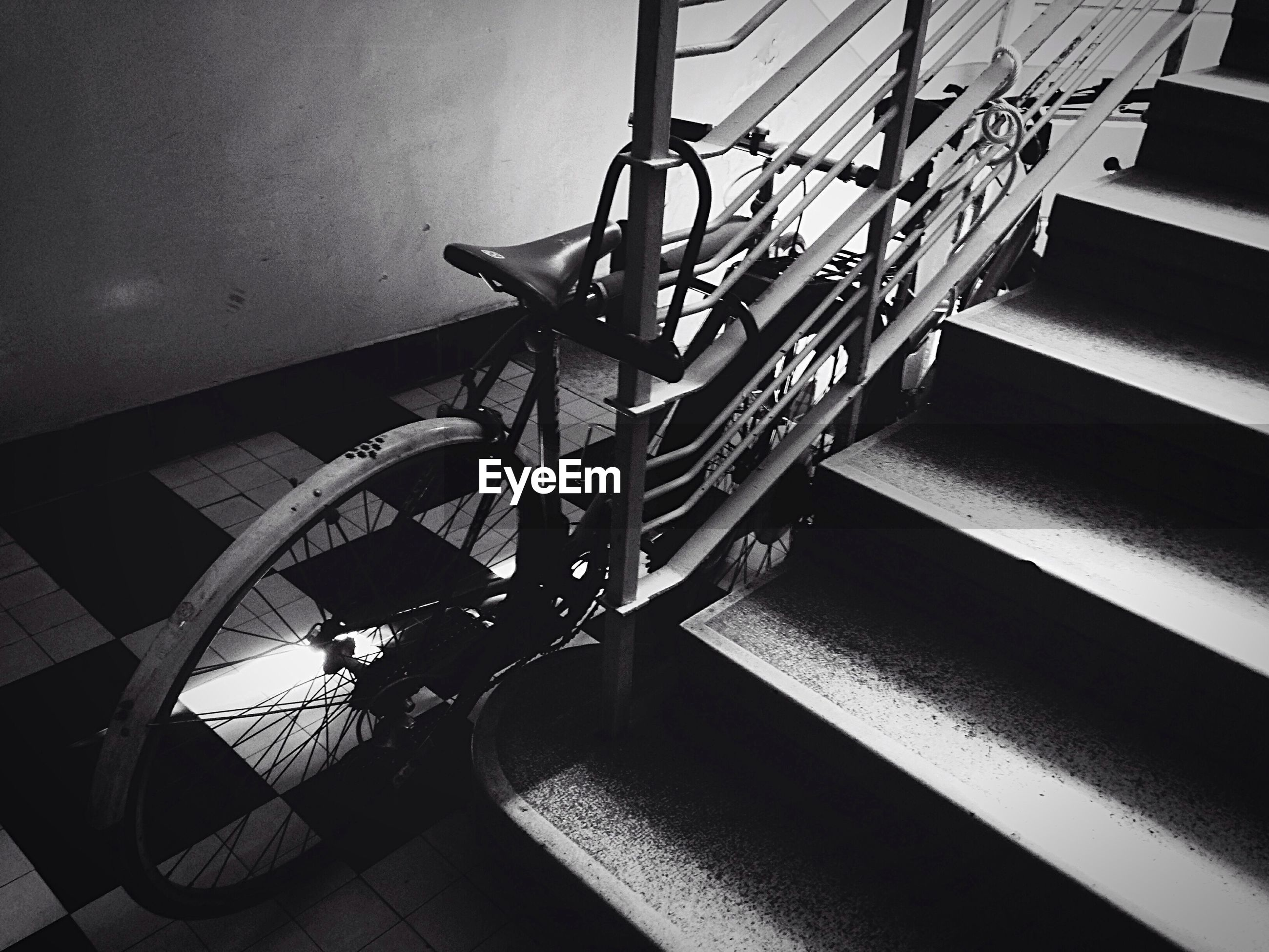 Bicycle parked by steps in building
