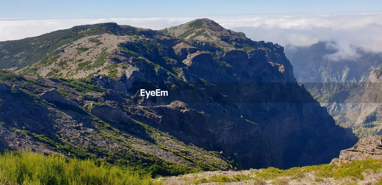 mountain, scenics - nature, beauty in nature, tranquil scene, non-urban scene, tranquility, landscape, mountain range, environment, sky, idyllic, nature, no people, day, cloud - sky, remote, land, physical geography, plant, geology, outdoors, mountain peak, formation, volcanic crater