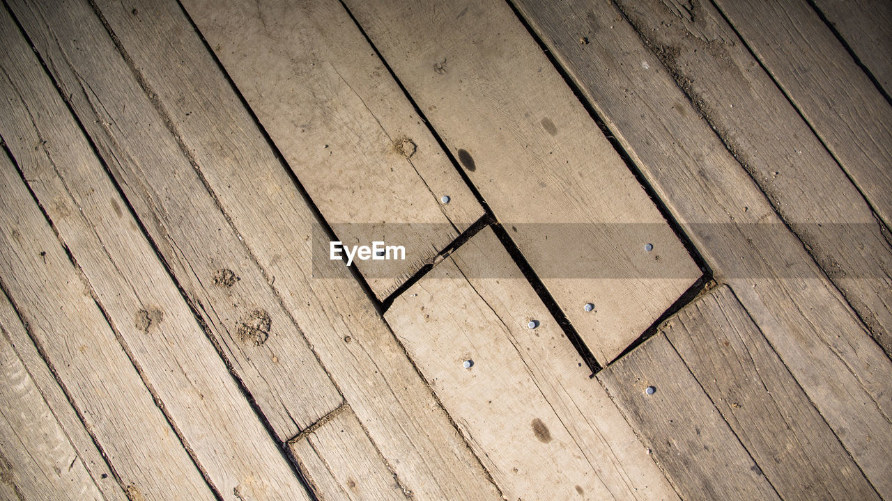 wood - material, wood, pattern, backgrounds, full frame, flooring, no people, indoors, hardwood floor, high angle view, textured, brown, plank, day, close-up, floorboard, geometric shape, design, shape, wood grain