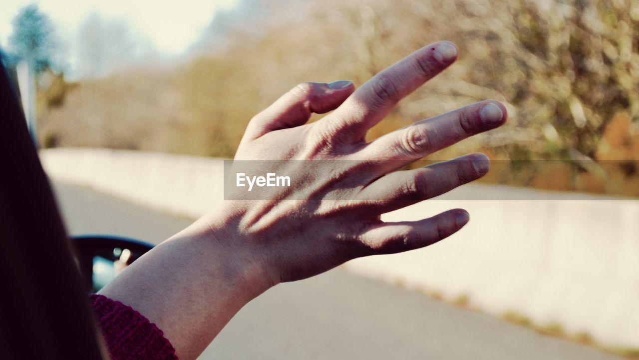 CLOSE-UP OF HANDS ON FINGER