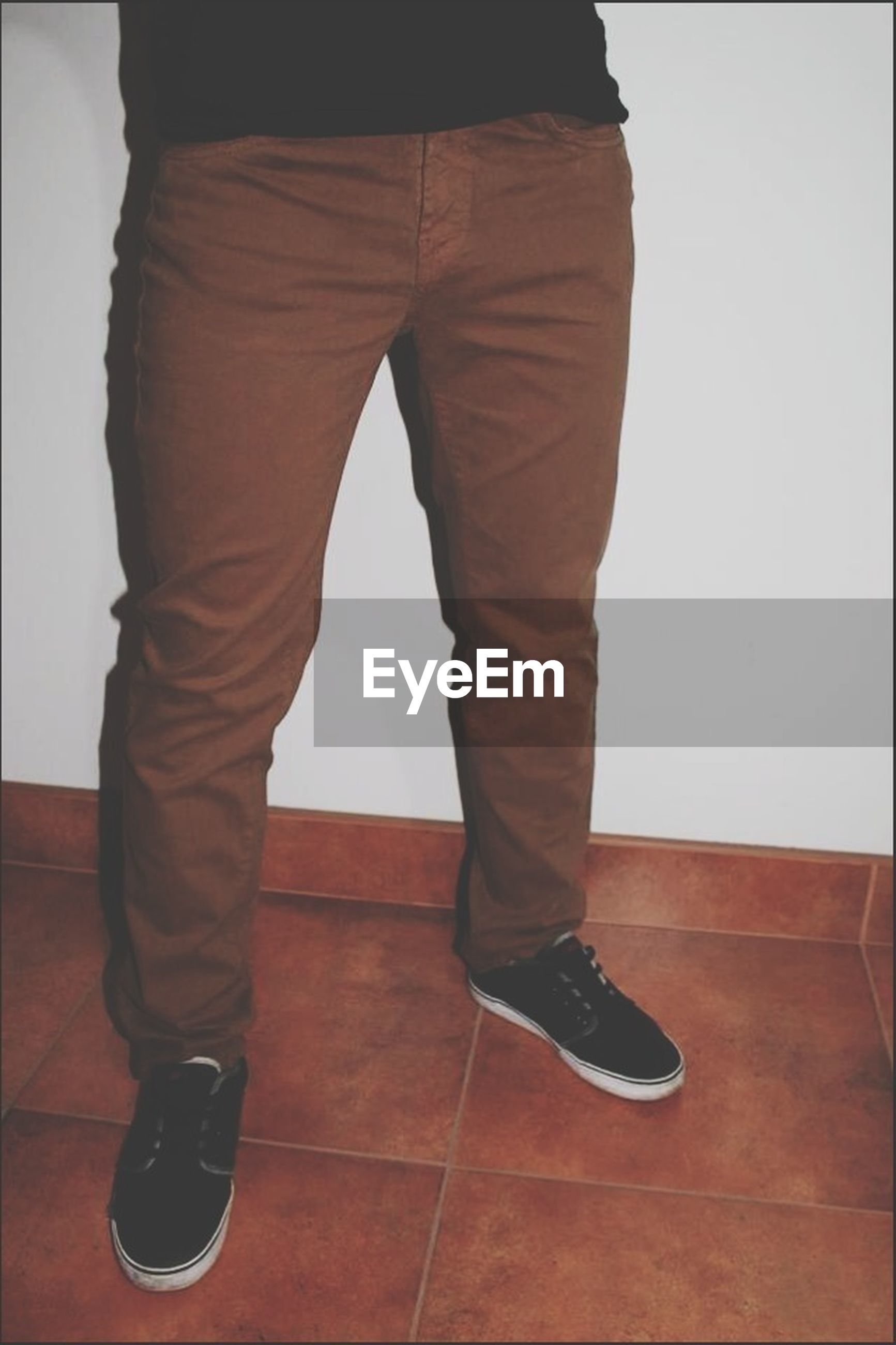 low section, standing, person, shoe, casual clothing, lifestyles, men, rear view, indoors, jeans, footwear, full length, leisure activity, human foot, copy space, wood - material