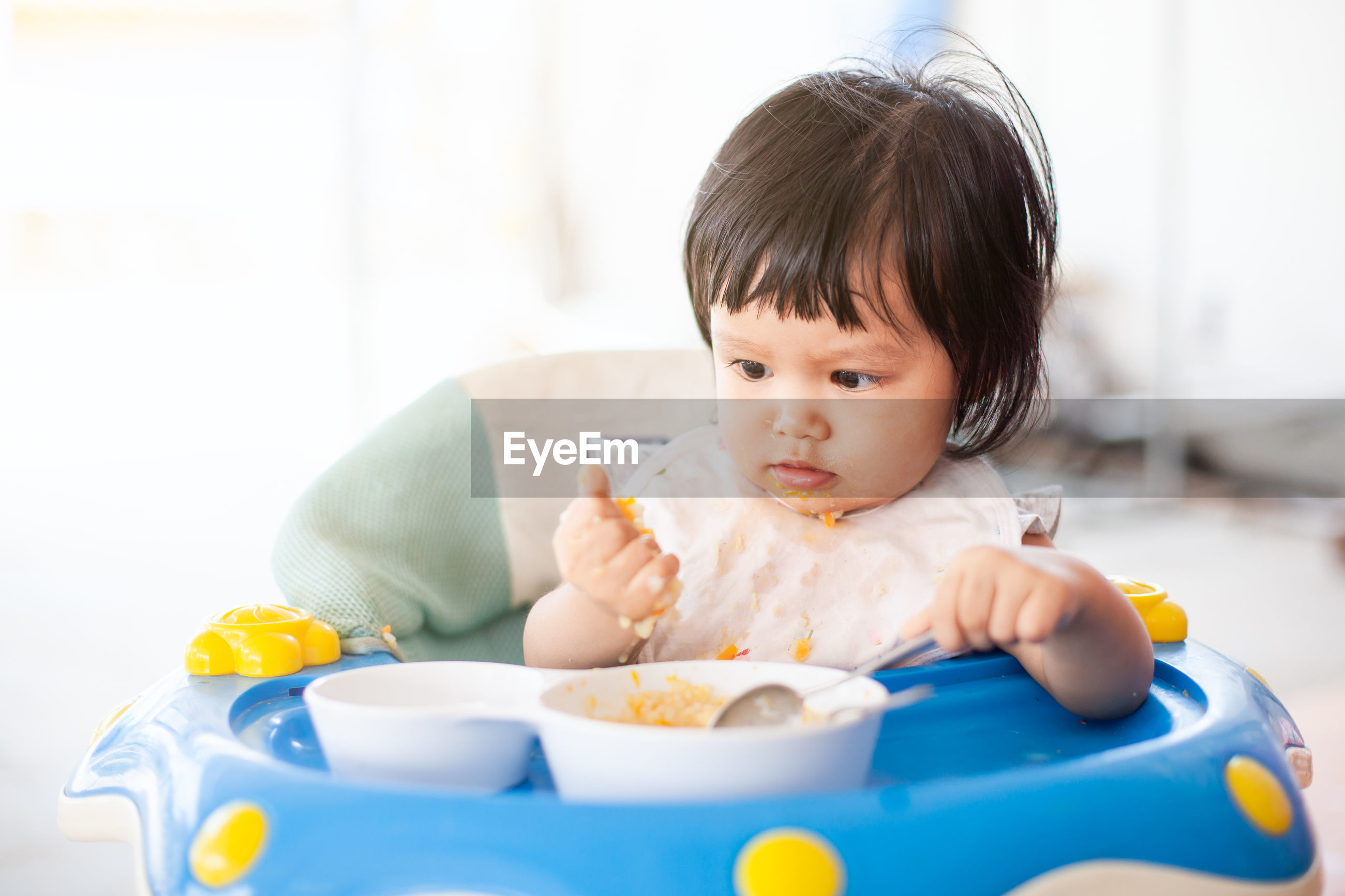 Close-up of cute baby girl eating food