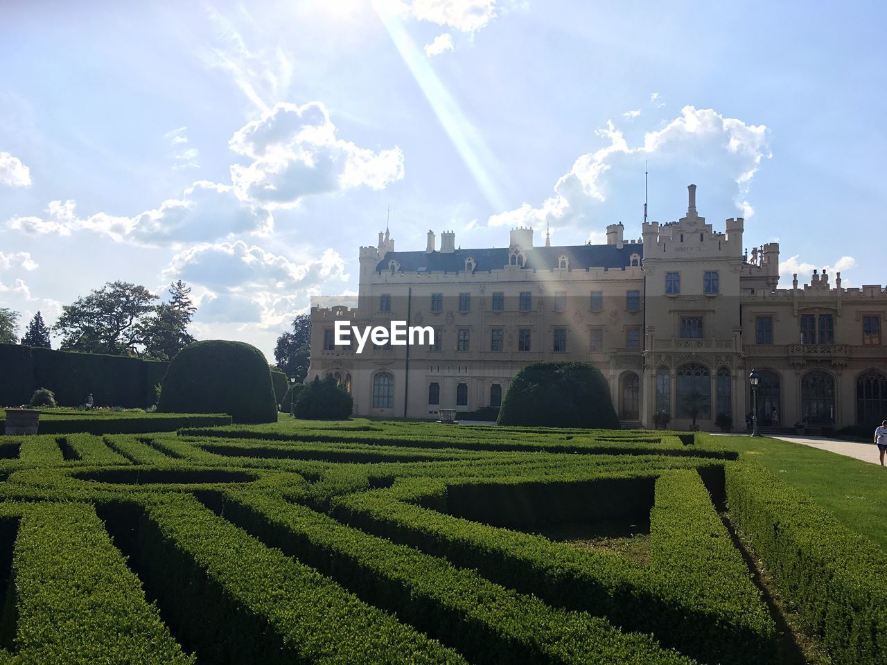 architecture, building exterior, built structure, cloud - sky, sky, nature, plant, day, building, sunlight, hedge, green color, garden, growth, outdoors, formal garden, no people, grass, tree, history