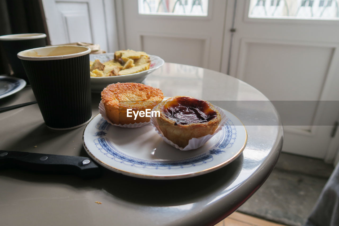 food and drink, food, table, plate, freshness, indoors, still life, sweet food, ready-to-eat, cup, no people, drink, dessert, coffee cup, coffee, mug, day, sweet, coffee - drink, refreshment, meal, breakfast, temptation