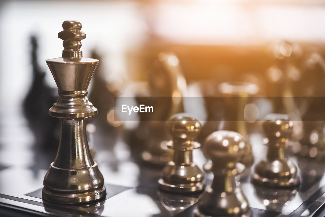 chess, board game, leisure games, game, chess piece, indoors, no people, still life, close-up, chess board, focus on foreground, metal, king - chess piece, leisure activity, relaxation, table, strategy, selective focus, pawn - chess piece, competition, queen - chess piece