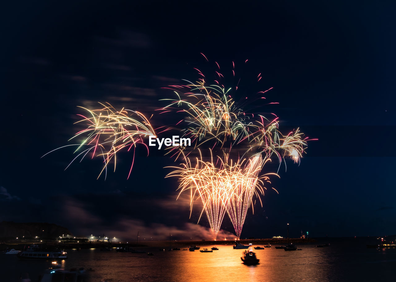 illuminated, night, firework, motion, water, celebration, sky, arts culture and entertainment, event, firework display, exploding, nature, long exposure, nautical vessel, transportation, no people, glowing, mode of transportation, reflection, firework - man made object, outdoors, light, sparks