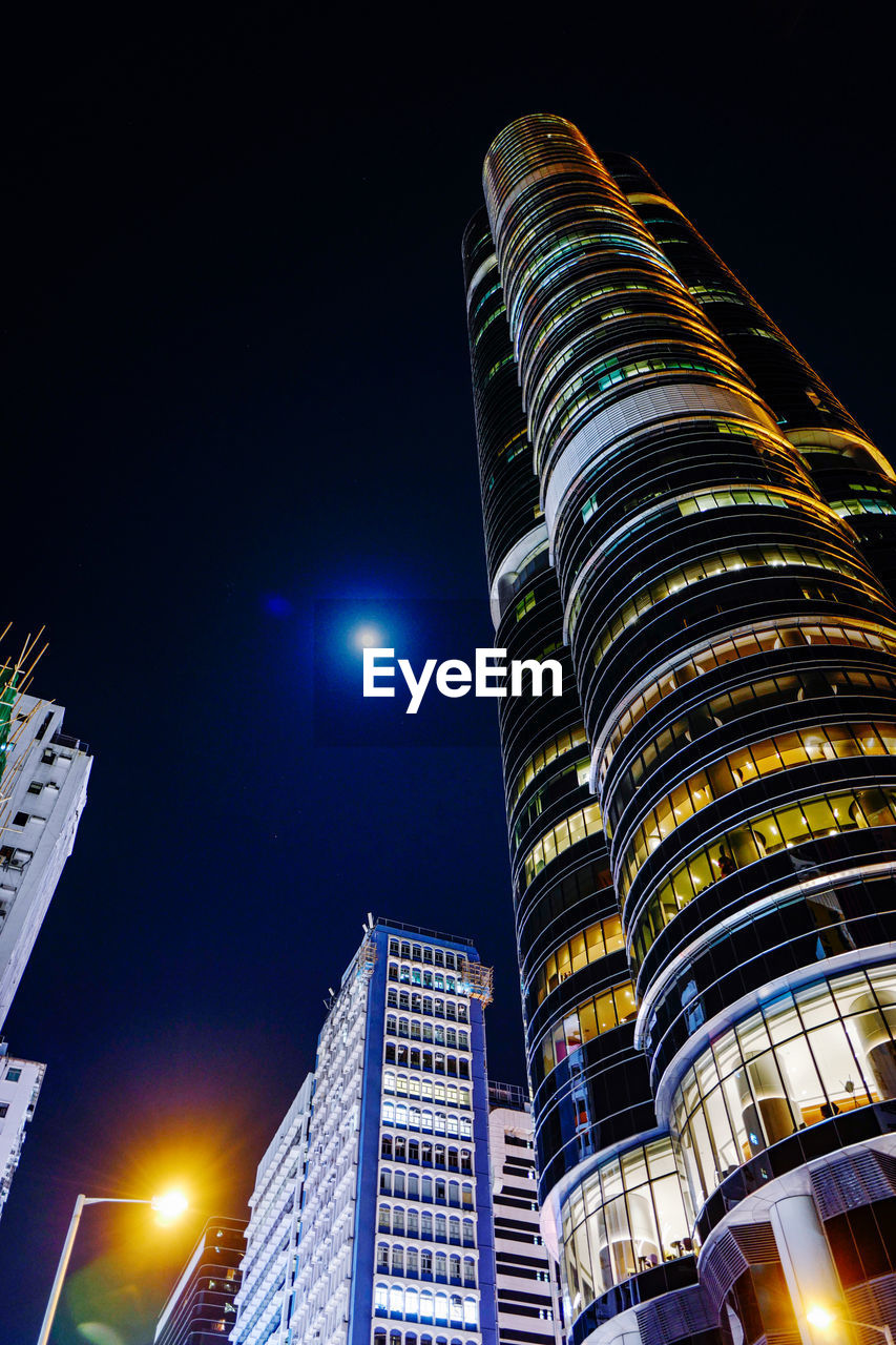 night, building exterior, illuminated, architecture, city, sky, built structure, office building exterior, building, tall - high, modern, low angle view, skyscraper, no people, tower, nature, moon, lighting equipment, glowing, office, outdoors, moonlight, financial district