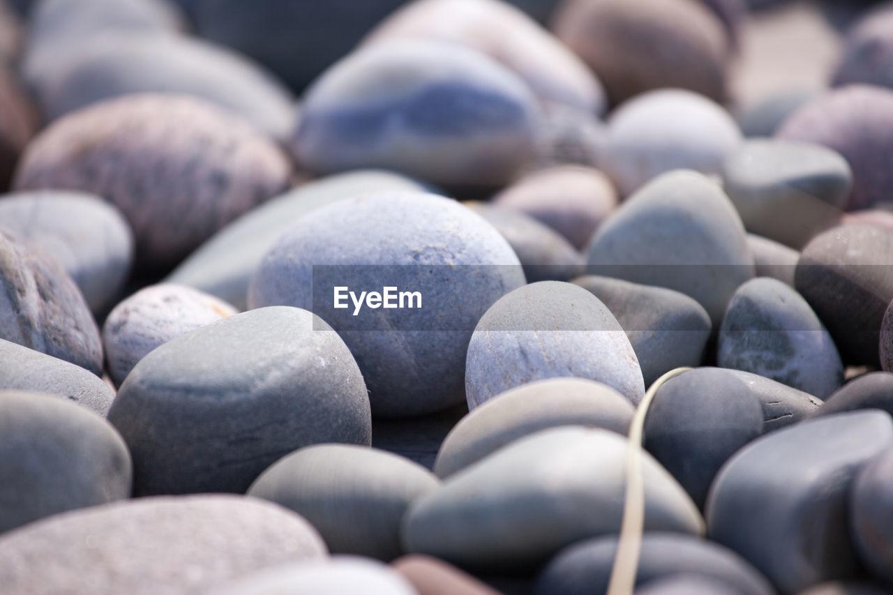Close-up of pebbles at beach