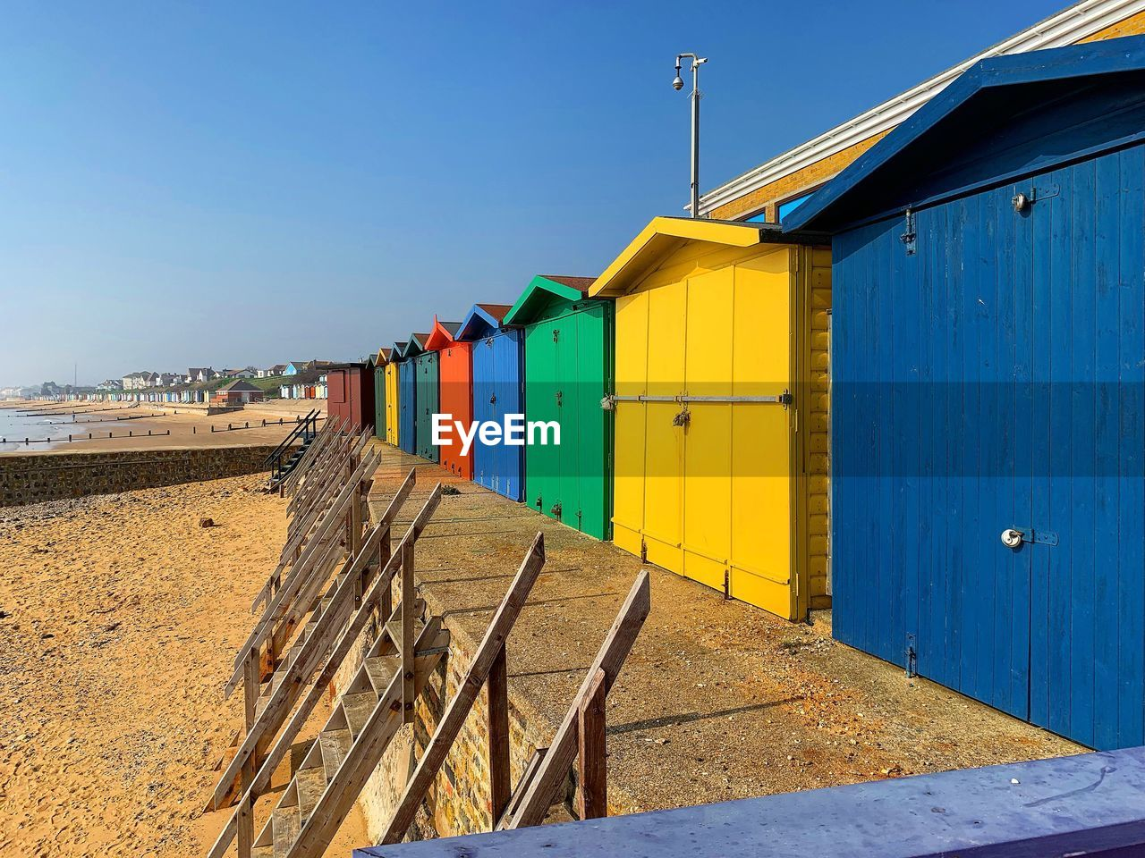 architecture, beach hut, built structure, hut, blue, multi colored, sky, beach, nature, wood - material, sand, building exterior, land, day, building, no people, clear sky, sunlight, house, outdoors, cabin