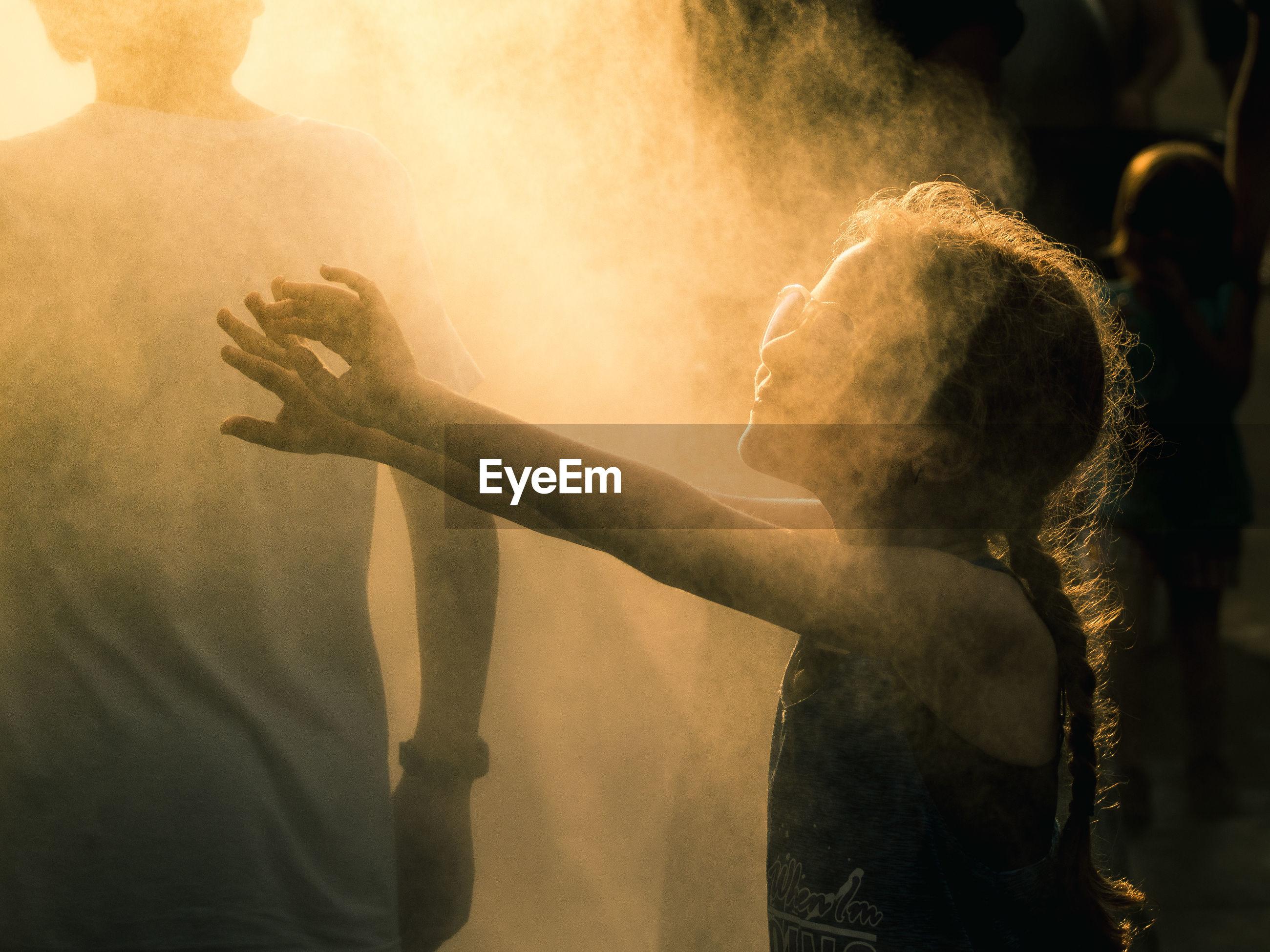 Shadow of woman in smoke