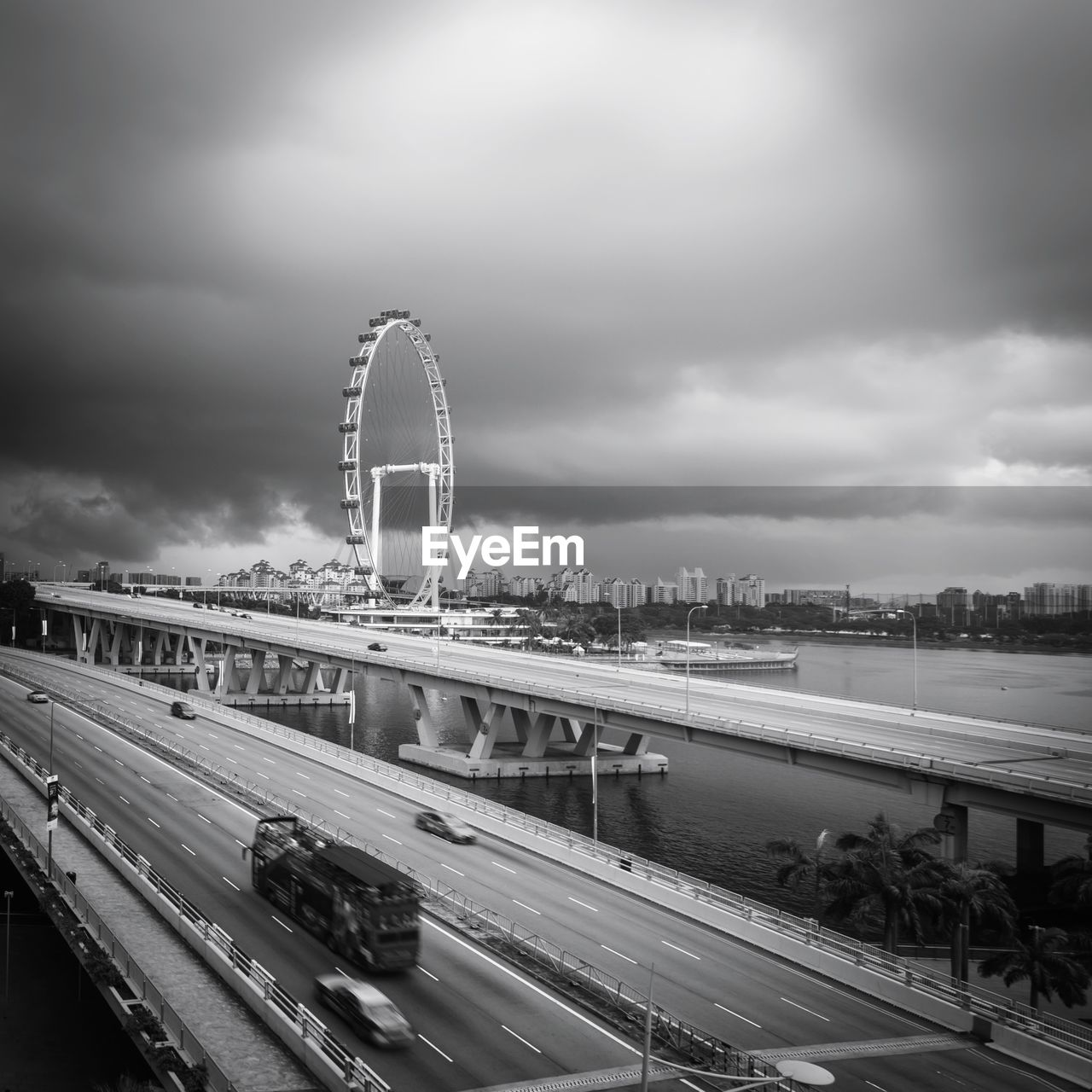 HIGH ANGLE VIEW OF HIGHWAY BRIDGE AGAINST CLOUDY SKY