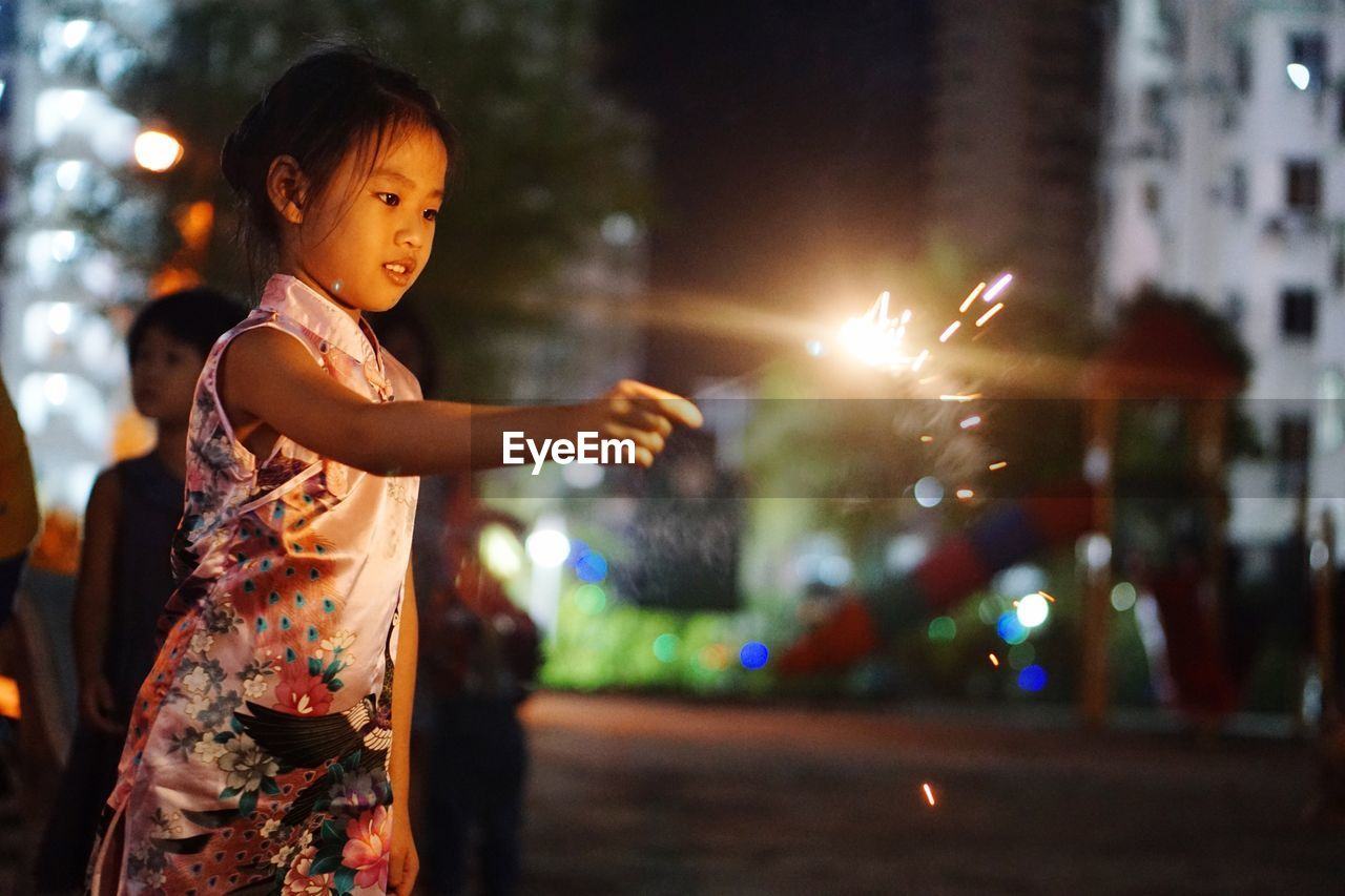 Young girl holding sparkler