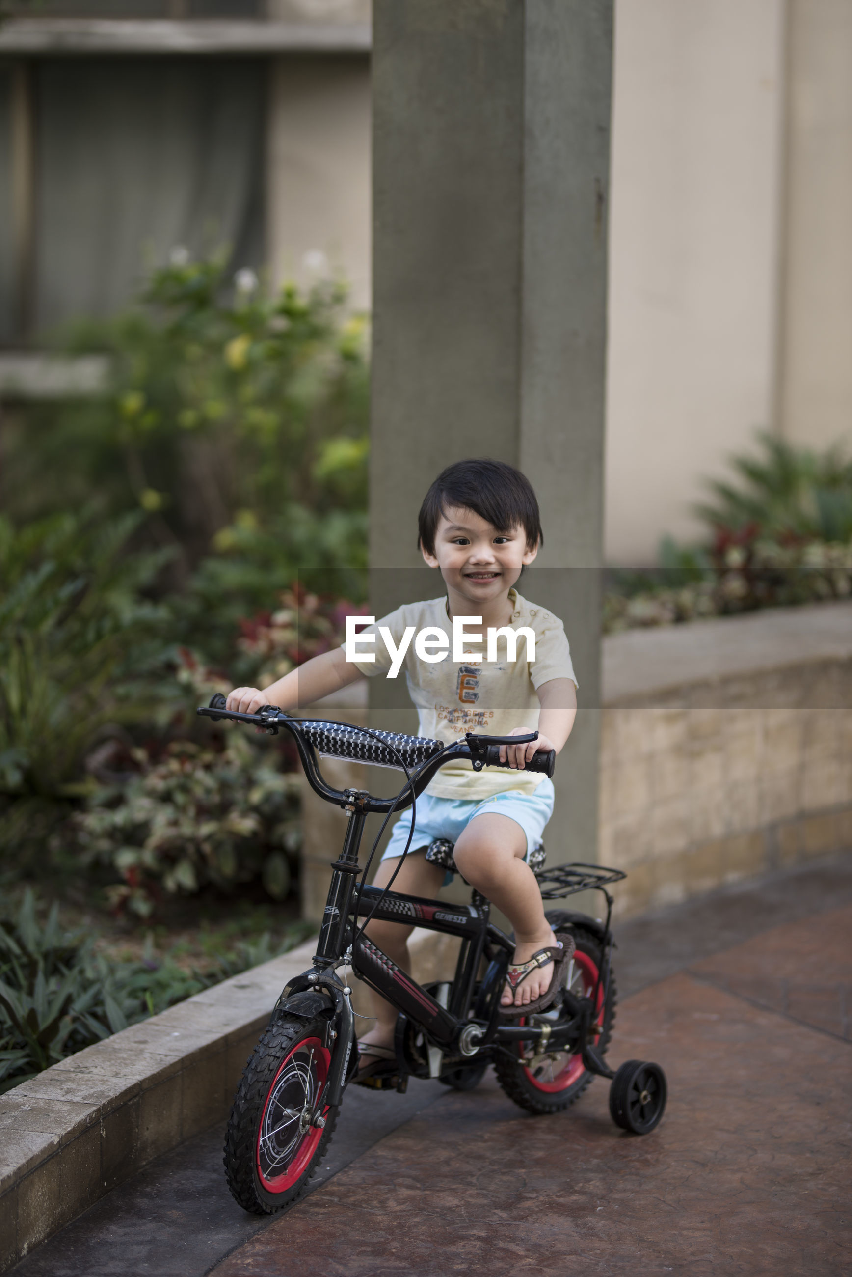 Portrait of cute boy riding bicycle
