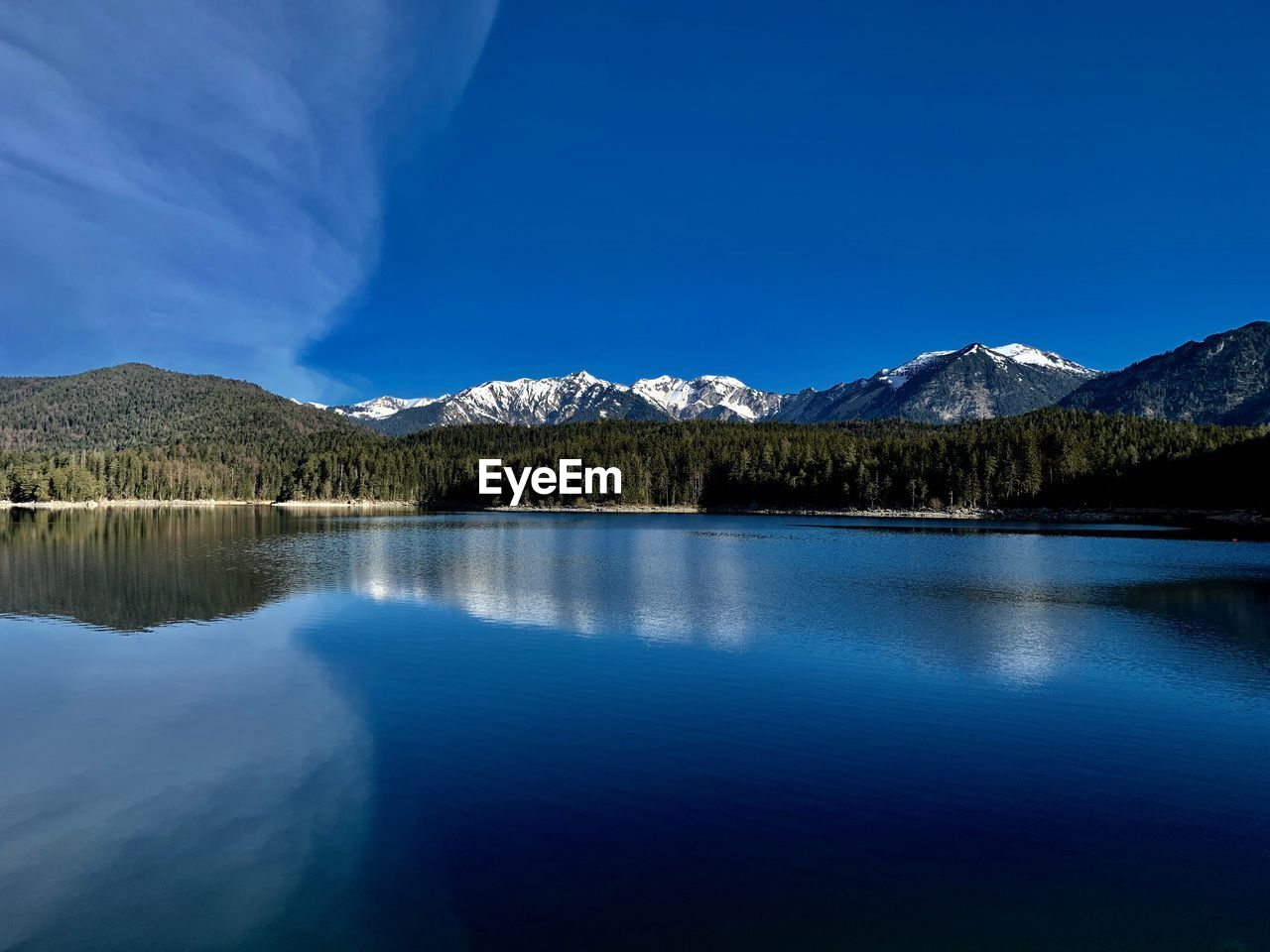mountain, water, beauty in nature, scenics - nature, lake, tranquil scene, sky, tranquility, reflection, waterfront, mountain range, nature, blue, idyllic, no people, non-urban scene, day, tree, clear sky, outdoors, snowcapped mountain, mountain peak