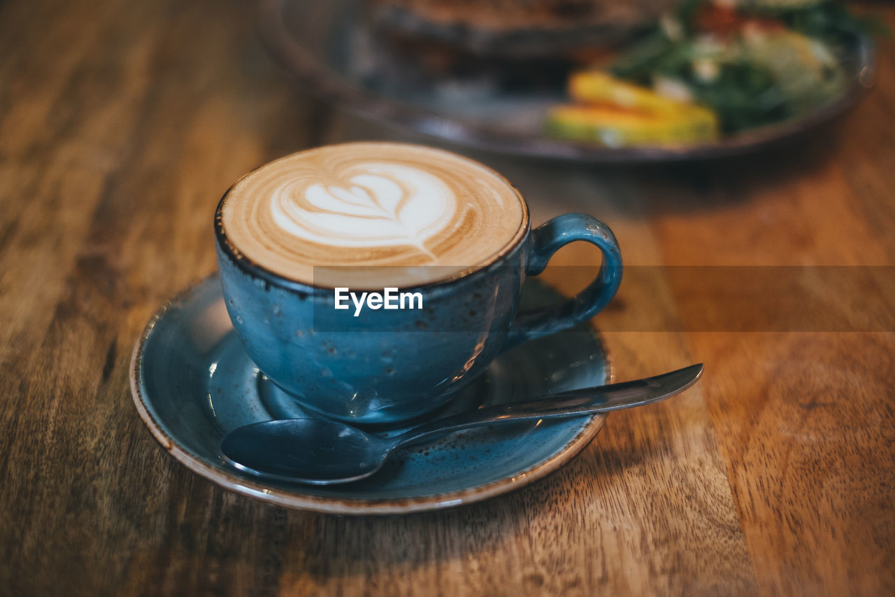 food and drink, coffee cup, saucer, still life, cup, refreshment, drink, mug, table, coffee, coffee - drink, cappuccino, crockery, hot drink, frothy drink, indoors, froth art, close-up, kitchen utensil, wood - material, no people, latte, non-alcoholic beverage
