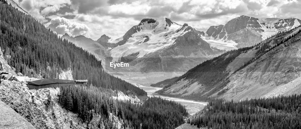 mountain, beauty in nature, nature, scenics, day, mountain range, tranquility, tranquil scene, outdoors, snow, lake, no people, sky