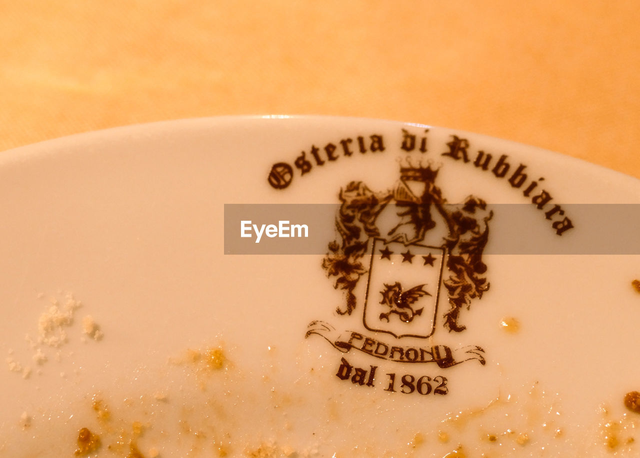 food and drink, close-up, indoors, text, no people, western script, still life, food, communication, coffee, coffee - drink, drink, freshness, high angle view, plate, cup, coffee cup, capital letter, refreshment, mug