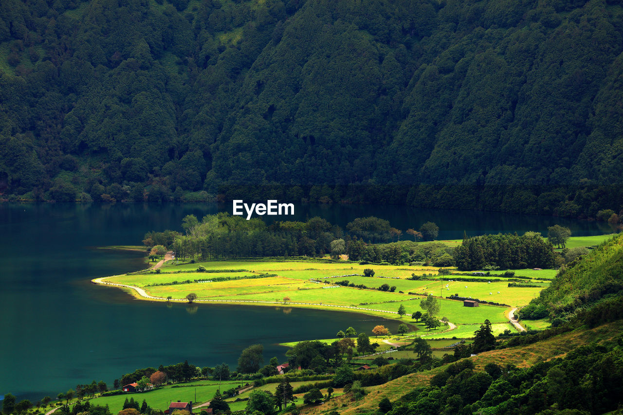 Scenic View Of Lake By Landscape Against Mountain