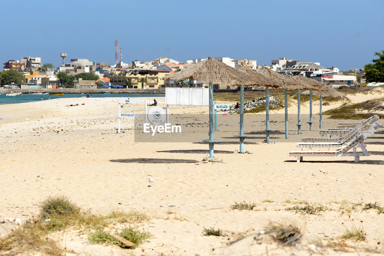 Sunshades And Lounge Chairs On Beach