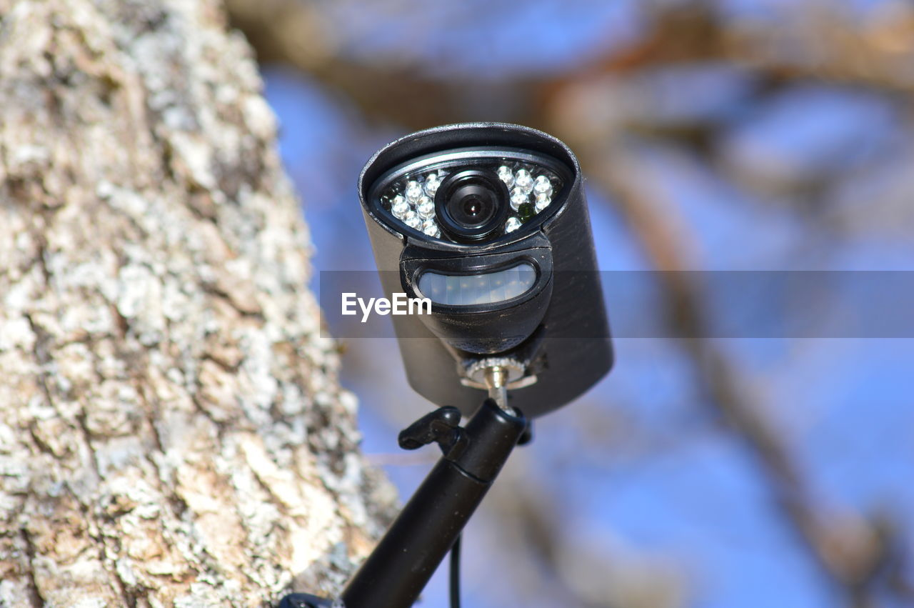 HIGH ANGLE VIEW OF CAMERA ON ROCK