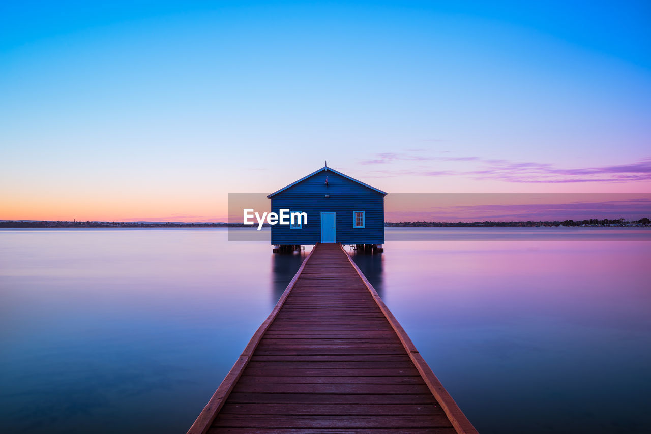 water, sky, built structure, scenics - nature, architecture, pier, beauty in nature, tranquility, sunset, sea, tranquil scene, wood - material, direction, no people, the way forward, nature, blue, idyllic, horizon over water, outdoors, purple
