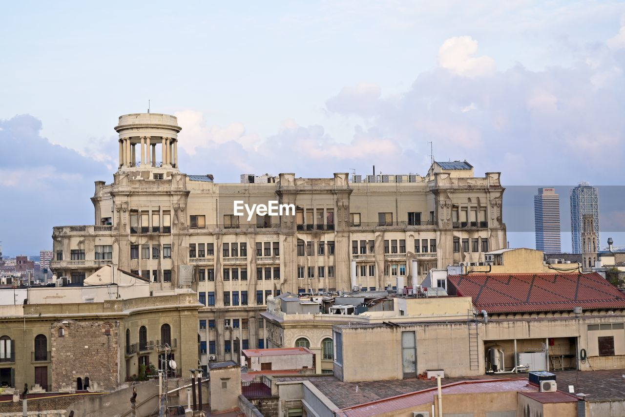 building exterior, built structure, architecture, sky, building, city, nature, cloud - sky, residential district, day, window, outdoors, travel destinations, roof, no people, sunlight, the past, town, history, apartment, townscape