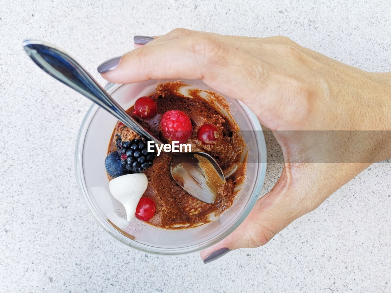 HIGH ANGLE VIEW OF HAND HOLDING BOWL OF FOOD