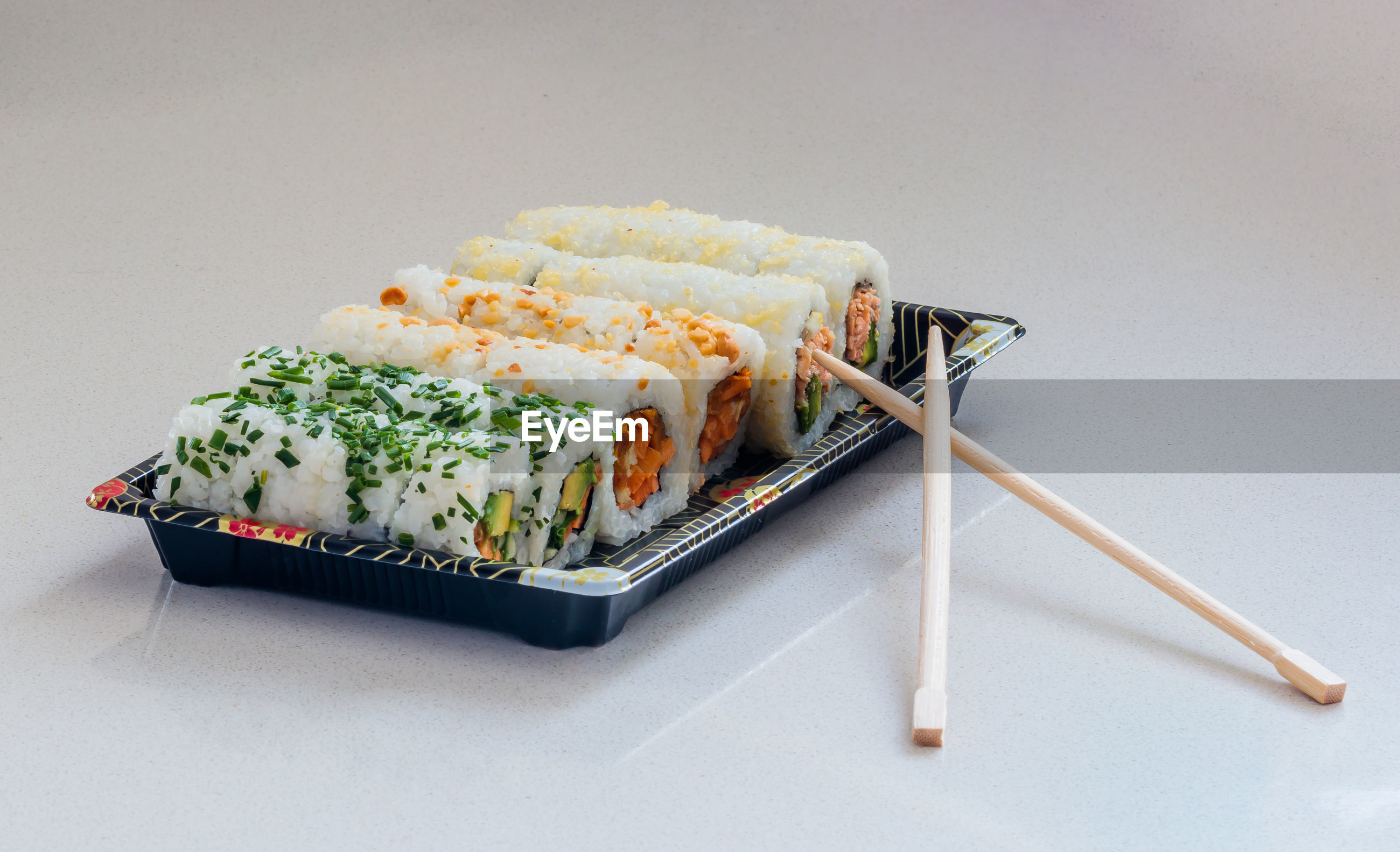 Sushi in plate on white background