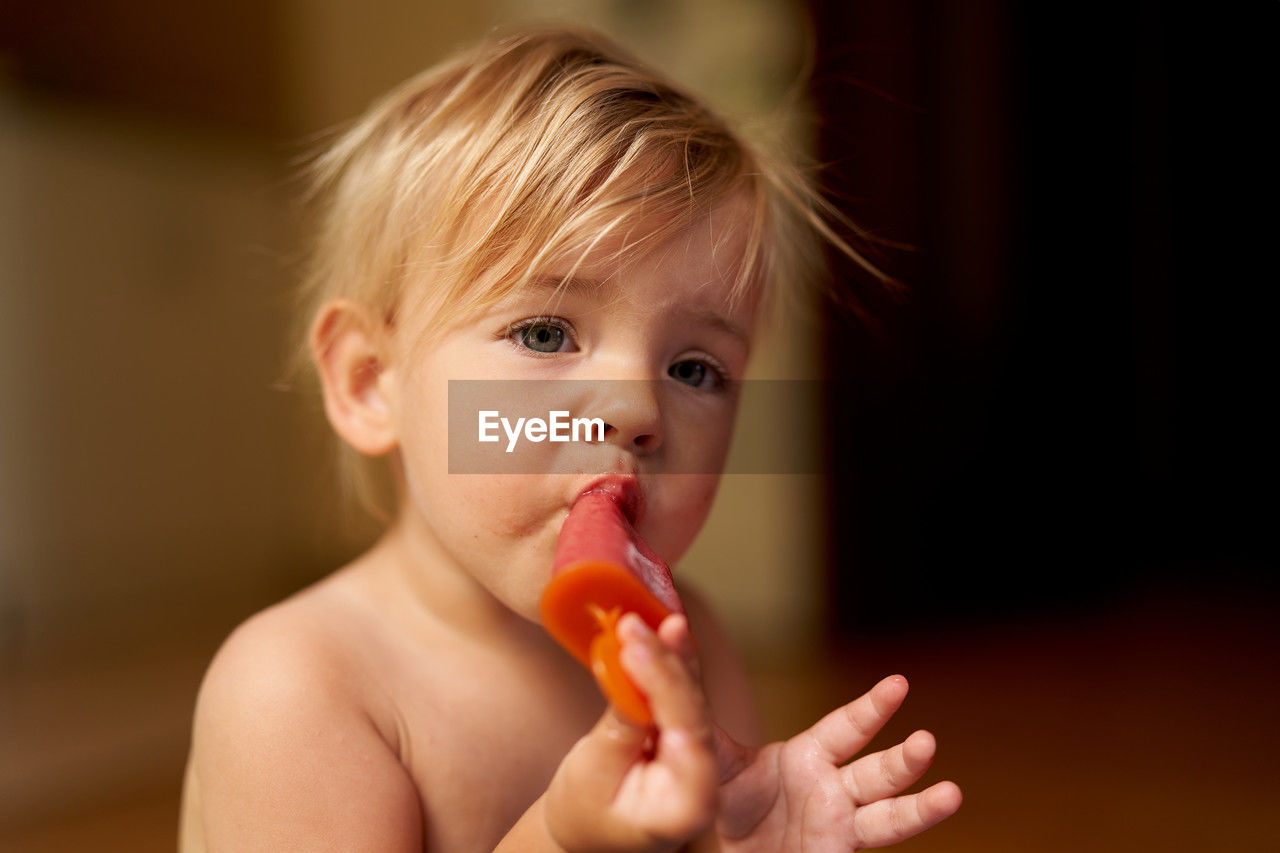 Portrait of cute boy eating ice cream