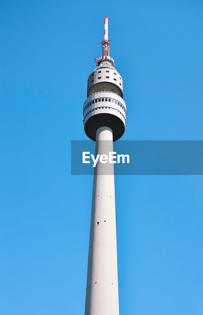 tower, low angle view, tall - high, built structure, building exterior, architecture, blue, clear sky, building, no people, sky, nature, travel, communication, day, technology, sphere, outdoors, global communications, spire, skyscraper, high
