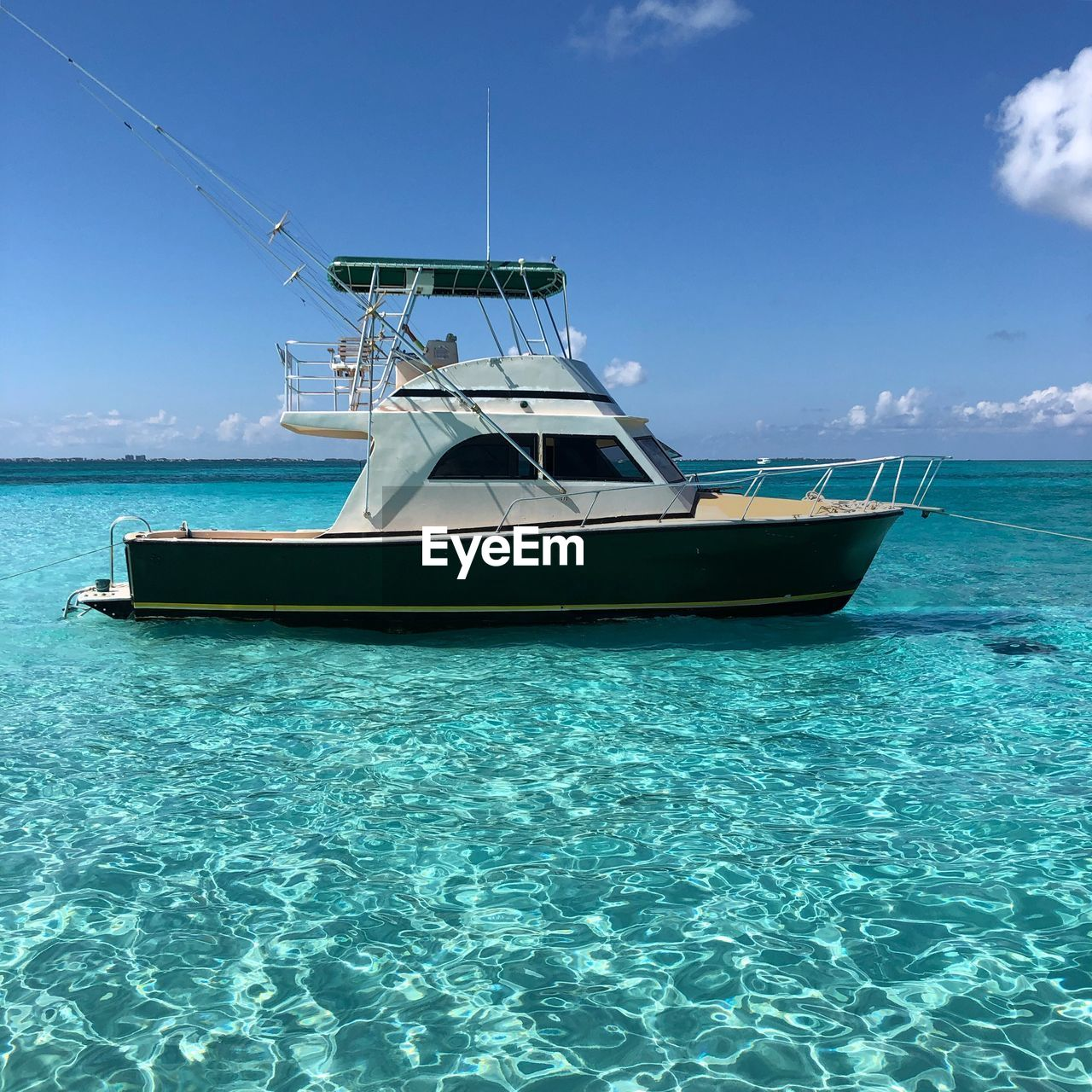 water, sea, nautical vessel, sky, nature, transportation, mode of transportation, scenics - nature, blue, beauty in nature, waterfront, day, cloud - sky, travel, sunlight, moored, horizon over water, no people, outdoors, turquoise colored, yacht, sailboat, anchored