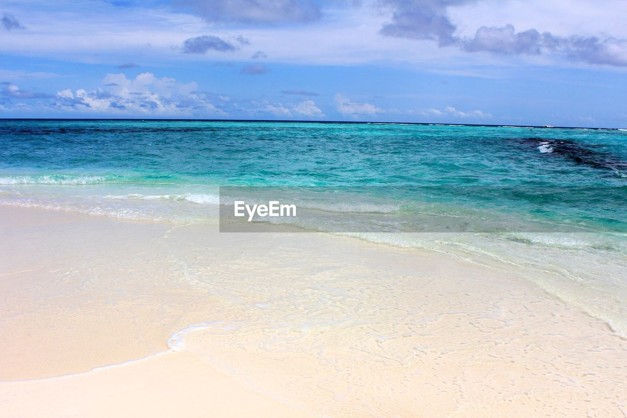 sea, water, land, beach, sky, beauty in nature, scenics - nature, horizon over water, horizon, tranquility, tranquil scene, cloud - sky, idyllic, nature, day, non-urban scene, blue, no people, sand, outdoors, turquoise colored