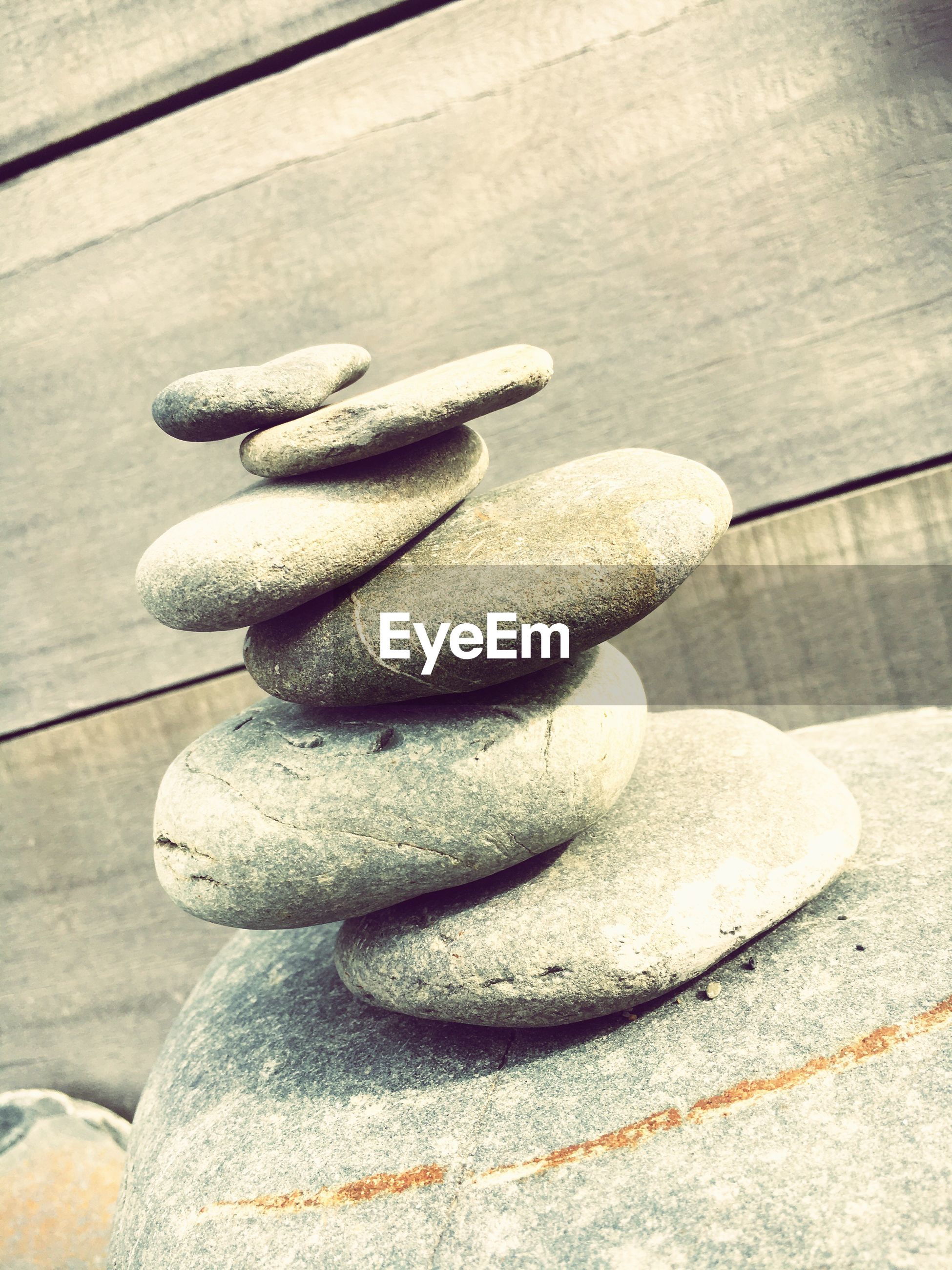 close-up, pebble, in a row, concrete, repetition, day, group of objects, outdoors, no people, full frame