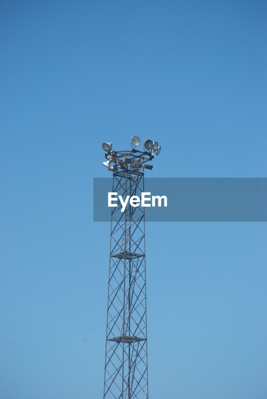 blue, sky, copy space, low angle view, clear sky, tower, communication, architecture, technology, tall - high, built structure, no people, metal, nature, antenna - aerial, day, wireless technology, outdoors, connection, global communications