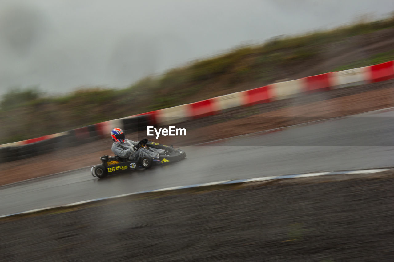 speed, blurred motion, transportation, motion, mode of transport, sports race, land vehicle, motorsport, riding, day, motorcycle, outdoors, helmet, real people, men, extreme sports, adventure, jet boat, one person, sky, people