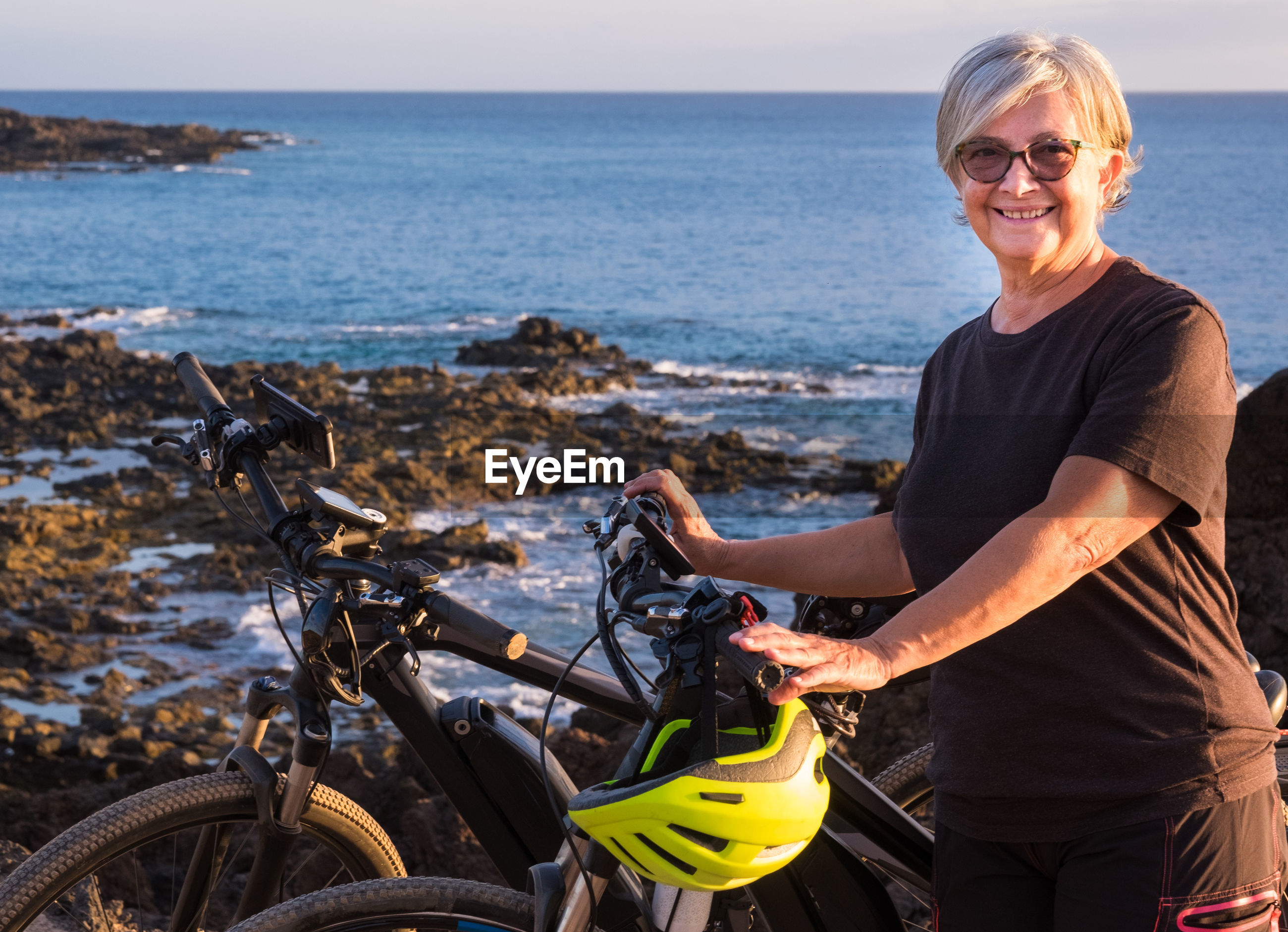 Woman with bicycle at beach